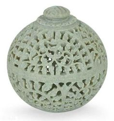 """Jasmine Rose : Natural Soapstone Jar in Hand-carved Jali   Finely carved in jali or openwork, jasmine vines swirl in lacy patterns.A rose crowns the lid.  Product Code : JR-1  Size: 5"""" H x 4.9"""" W x 4.9"""" D  Weight: 1.5 lbs"""