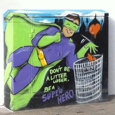 Brighton street art / graffiti: 'Don't be a litter loser be a Super Hero' on a BT junction box