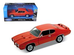 1969 Pontiac GTO Judge Orange 1/24 Diecast Model Car by Welly - Brand new 1:24 scale diecast model of 1969 Pontiac GTO Judge Orange die cast car model by Welly. Brand new box. Rubber tires. Has opening hood and doors. Made of diecast with some plastic parts. Detailed interior, exterior, engine compartment. Dimensions approximately L-7.5,W-3,H-2.5 inches. Please note that manufacturer may change packing box at anytime. Product will stay exactly the same.-Weight: 2. Height: 6. Width: 11. Box…