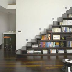 Bookcase built into a staircase. Love it!