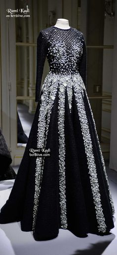I would make the top part plain and have the embroidery start just above the waist..more of a lengha style