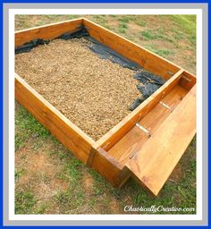 Rock box instead of sand box with built in toybox/bench