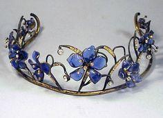 Gripoix Tiara  1930s  Blue pate de verre flowers set on gilt-metal vine-like structure, rhinestone pendants.