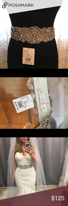 Wedding crystal sash belt NWT Brand new ivory beautiful crystal belt with tag! I bought to wear for my wedding but decided not to wear it. Very sparkly under lights! David's Bridal Accessories Belts