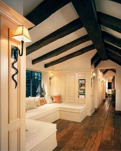 Awesome Traditional Hallway With Decorative Pillow, Serpent Wall Sconces, Exposed  Beam, Built In Bench Seating, Window Seat