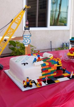 Joes next bday cake? Hes has the whole construction lego set. White cake with one corner cut out and filled in with chocolate Lego bricks. Lego men, crane and front loader are real legos. Bolo Lego, Lego Cake, 6th Birthday Parties, Cake Birthday, Lego Parties, Birthday Boys, Diy Lego Birthday Party Ideas, 5th Birthday Ideas For Boys, Lego Party Games