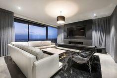 Luxury entertainment area next to ocean faced huge slide windows by Zorzi Builders