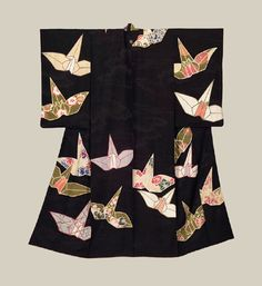 """Taisho Kimono - Taisho era (1912-1926). A high-grade rinzu silk kimono that features large, bold paper-crane motifs throughout. These motifs were created using the yuzen dyeing technique. Gold surihaku (metal leafing) outlining. A single mon (family crest) on the back. 49"""" from sleeve-end to sleeve-end x 59"""" height. The Kimono Gallery"""