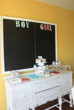 """Somewhere by front door, have Ben's """"baby reveal"""" pic framed, next to """"boy or girl"""" board. Or, on piano.    Can use bulletin board...have bows & mustaches cut out in pink & blue. Ribbon & cut out letters for labels"""