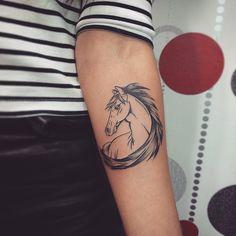 Simple dot work horse tattoo..