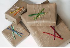 colorful and easy - branches and twigs covered in  holiday-inspired colors create perfect present toppers or a simple yet stunning table arrangement