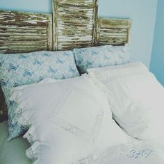 Working on the guest room today.  #paleblue #chippyshutters #headboard #lakecabin #sunbakedtreasures #germanbedding