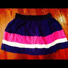 Forever 21 medium striped mini skirt Forever 21 medium mini skirt. It has an elastic waist and it is navy, purple, & creme striped. It is 100% rayon and flows very nice. No stains or rips in the fabric. Looks Great!! Forever 21 Skirts Mini