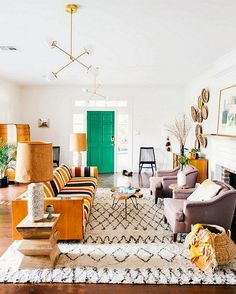 Bright and eclectic Moroccan-meets-midcentury living room bursting with color and pattern.