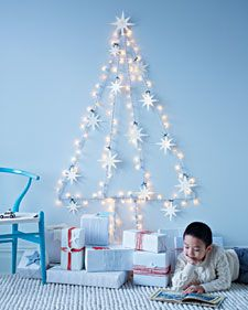 """DIY string-light """"wall tree"""" with felt star ornaments...perfect for places too small for a real tree"""