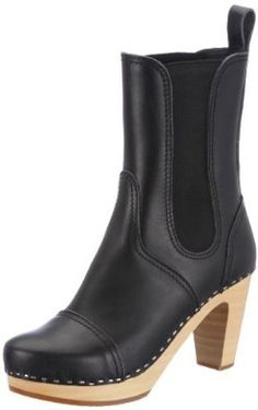 "Swedish Hasbeens Women's 60's Slingback Sandal swedish hasbeens. $311.25. Heel measures approximately 3.5"". leather. Platform measures approximately 1"" . Manmade sole. Made in Sweden"