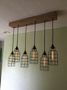 Linear Wood Chandelier with Black Metal Cage by IndustrialRewind Industrial Farmhouse Kitchen, Rustic Industrial, Kitchen Dining, Wood Chandelier, Rustic Curtains, Black Metal, Cabins, Cage, Blinds