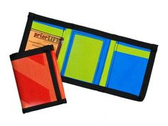 This hip, eco-friendly wallet is crafted from recycled vinyl banners. It includes credit card holders, one clear window for an identification card, and a money slot, not to mention it's packed with unique style as no two are alike!