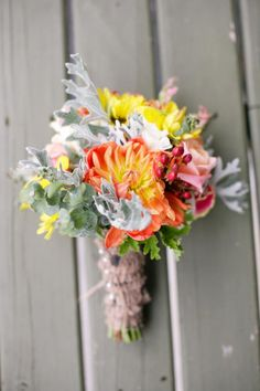 Gorgeous vintage-looking bouquet with minty greens, orange, yellow and cranberry