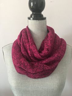 Maroon red infinity scarf.  Stay warm and fashion forward in this vibrant knit purply maroon/red with black flecks circle scarf. Definitely one of a kind.  Measures 11 inches wide and 58 inches in circumference.  Materials: cotton, poly
