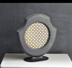 old speaker for sale on etsy - functional with real speaker system, but I want to look for one at the thrift store to turn into a jewelry rack. :) (maybe I could use for music & jewelry)