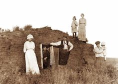 A PIONEER FAMILY AND THEIR LITTLE SOD HOUSE ON THE PRAIRIE