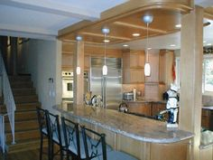 Columns on kitchen island; hanging lights placement