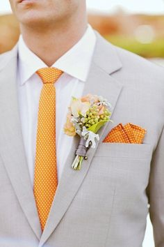 Pale gray suit gets an infusion of color from boutineer, pocket handkerchief, & tie.  / GIDEON PHOTOGRAPHY