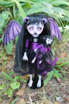 This is Daria Dragon.  She is a little dragon girl. She is a posable soft body doll.  Her head, hands, and feet are made of polymer clay