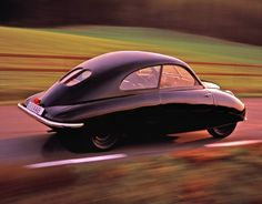 ❦ 1942 Saab 92001 Prototype. Wow. This is disgusting. It's a stretched beetle with some small windows.