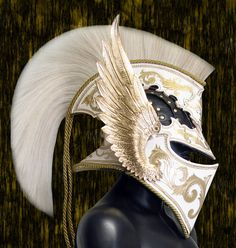 Pinning for the wings on the side. I want to make something similar out of leather as a crest for my helm. Archangel Helmet by =Azmal on deviantART