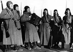 Russian soldiers with gas masks and an accordian