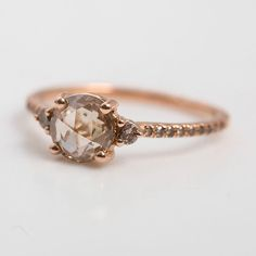 The beauty of a shining diamond and a small scar. The Champagne Diamond Solitaire by Blanca Monrós Gómez, at catbirdnyc.com.