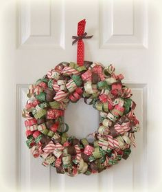 This colorful wreath is handmade from paper! DIY this Christmas wreath in different colors to celebrate each holiday