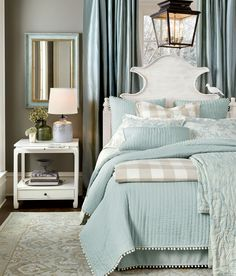 We used a dark gray wall color to contrast our prettiest shade of spa blue in this bedroom.