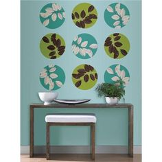 A pretty blue wall donned in a natural decor scheme #habitatdots #walldecals #polkadots