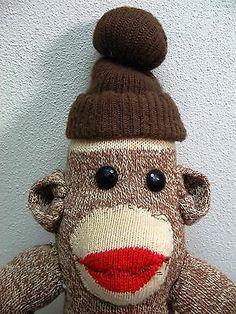 Sock monkey - love the beanie! Socks And Heels, Red Heels, Sock Monkey Cupcakes, Oz Tattoo, Tin Can Crafts, Sock Dolls, Sock Monkeys, Sock Animals, Monkey Business