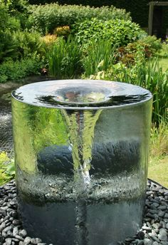 The stunning Volute water feature by Tills Innovations. A vortex being captured and displayed in clarity and detail. What appears to be a solid piece of glass with a spinning vortex. A mesmerising water feature.                                                                                                                                                                                 More