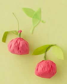 Possible favors.  These candy-filled bundles are a cinch to make: Wrap a handful of cherry sour balls in red tissue, twist closed, and add floral-wire stems and paper leaves.