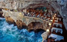 a Mare in southern Italy (province of Bari, Apulia), lies a most unique dining experience at the Grotta Palazzese.Polignano a Mare in southern Italy (province of Bari, Apulia), lies a most unique dining experience at the Grotta Palazzese. Most Romantic Places, Beautiful Places, Amazing Places, Amazing Hotels, Exotic Places, Beautiful Hotels, Beautiful Gorgeous, Stunning View, Beautiful Vacation Spots