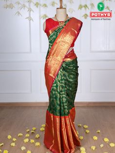 The traditional ethnic green Samudhrika silk saree with the shade of gold silk sewing in the body of the saree with contrast red border makes it perfect for the beautiful bride. #pattusaree #silksaree #puresilk #saree #traditionalsaree #sareedesigns #sareestyles #weddingsaree #bridallook #sareelooks #sareeforbrides #sareedraping #draping #samudrikasarees #handloomsaree #pattusaree #bridalsaree #vocalforlocal #sareeembroidery #BestSarees #lightweightsaree #kanchipuramsilksaree #puresilksaree