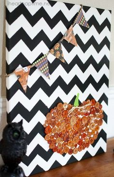 DIY halloween canvas. 1. use tape to do chevron print. 2. use scrapbook paper for banner 3. use buttons for pumpkin