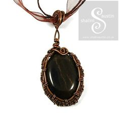 Copper Wire Woven to create a setting for this beautiful piece of Petrified Wood.The copper has been given an antique finish using Liver of Sulphur. As with all natural stone pieces this is a one off piece of jewellery. I