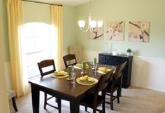 Extra chairs in the corners add to the decor and remain on stand-by for when extra seating is needed in this dining room! Highland Homes' Remington IV model home in Ocala, Florida.  #decorating #decor
