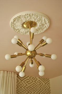 Gold Sputnik Light Fixture in this Gold Glam Nursery