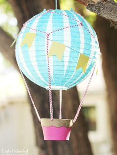 This paper hot air balloon with vintage flair is sure to add charm to any birthday party décor. You can even easily add an LED tea light to convert it into a lantern.