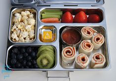 """Here's what's inside: Pizza """"Sushi"""" (spread cream cheese onto a low carb tortilla, layer with slices of pepperoni, roll it up, and slice into rolls)= 15 carbs 2 Tablespoons Pizza Sauce (for dipping)= 3 carbs Strawberries= 4 carbs Carrots & Celery= 1 carb Blueberries= 4 carbs Kiwi= 5 carbs Angie's Kettle Corn Popcorn= 5 carbs 1 Starburst candy= 4 carbs Lunch Total= 41 carbohydrates"""