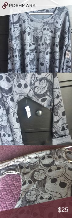 Nightmare Before Christmas Long Sleeve top Disney Nightmare Before Christmas long sleeve top. Medium gray color. New from Disneyland. Size L. Fits really big in the stomach torso section. More like an XL or XXL Disney Tops Tees - Long Sleeve