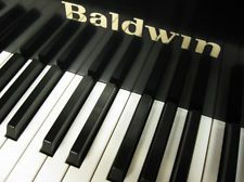 """Baldwin R  5'8"""" Baby Grand Pianohe Baldwin Piano Company is recognized as one of the finest piano manufacturers in its day. Baldwin Grand Pianos have made their homes in world class American Concert Halls, Universities and in residences of the finest artists Including Dave Brubeck, George Bolet, Carly Simon and Phillip Glass. The Baldwin Model R is the smallest Artist Grand Piano. This instrument has been finished in a beautiful satin ebony."""