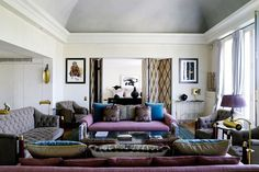 Discover stylish living room design ideas on HOUSE - design, food and travel by House & Garden. This sunburst gold and black screen, by Laurent Leveque, punctuates the living space.